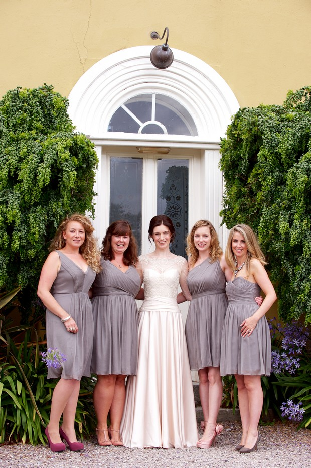 Bridesmaids in short grey dresses
